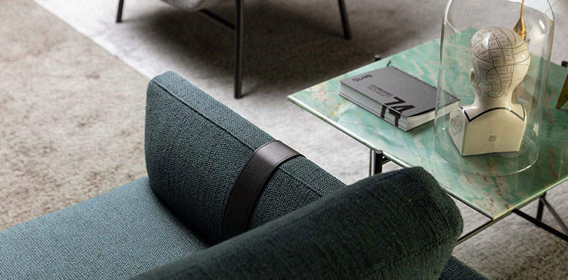 Leather straps that wrap around the armrests of the Dee Dee sofa  Berto